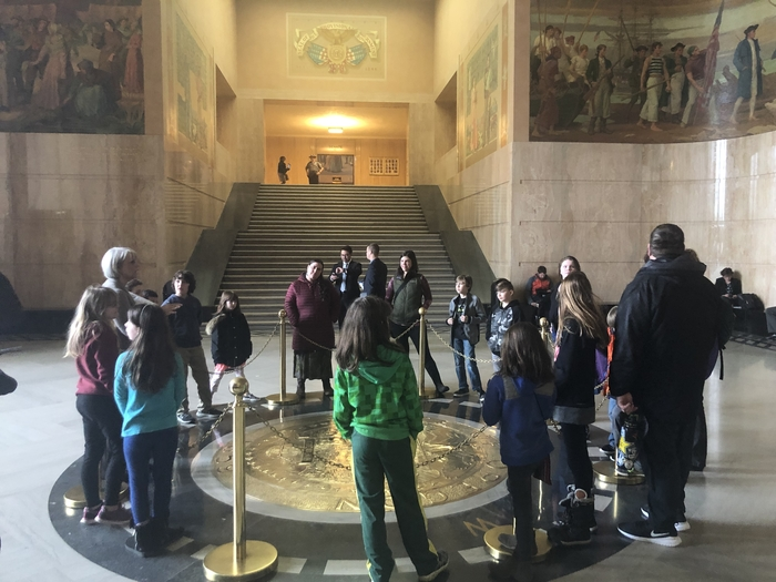Gathering around the State Seal in the Capitol rotunda.