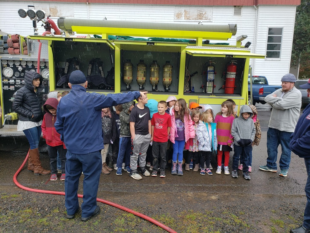Students brave the rain to learn about fire safety.