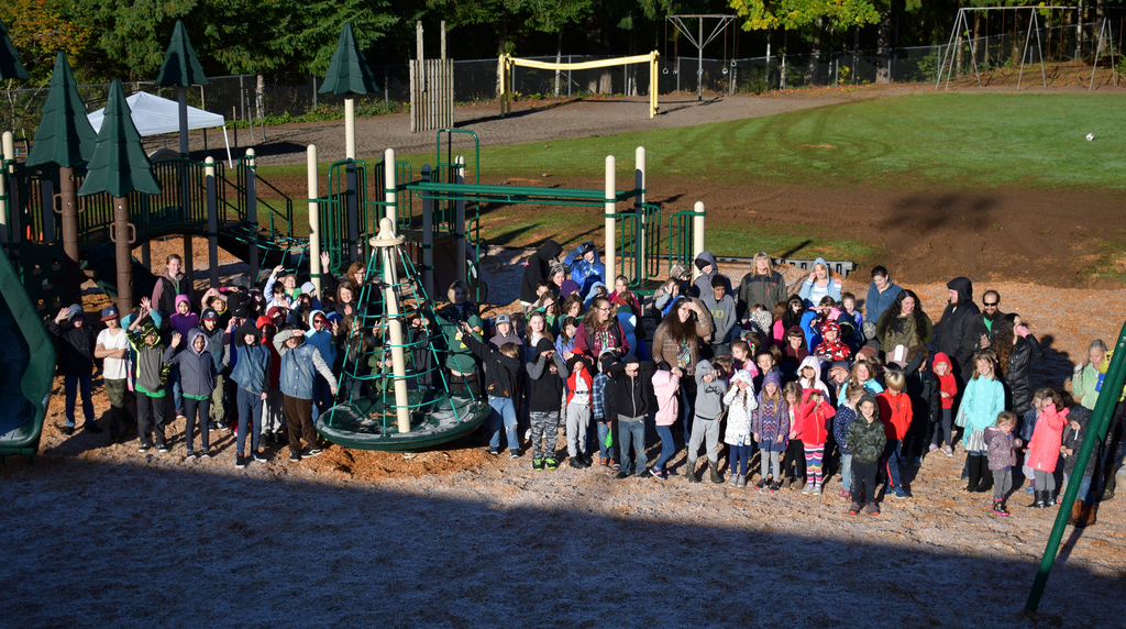 Elementary staff and students on the new playground.