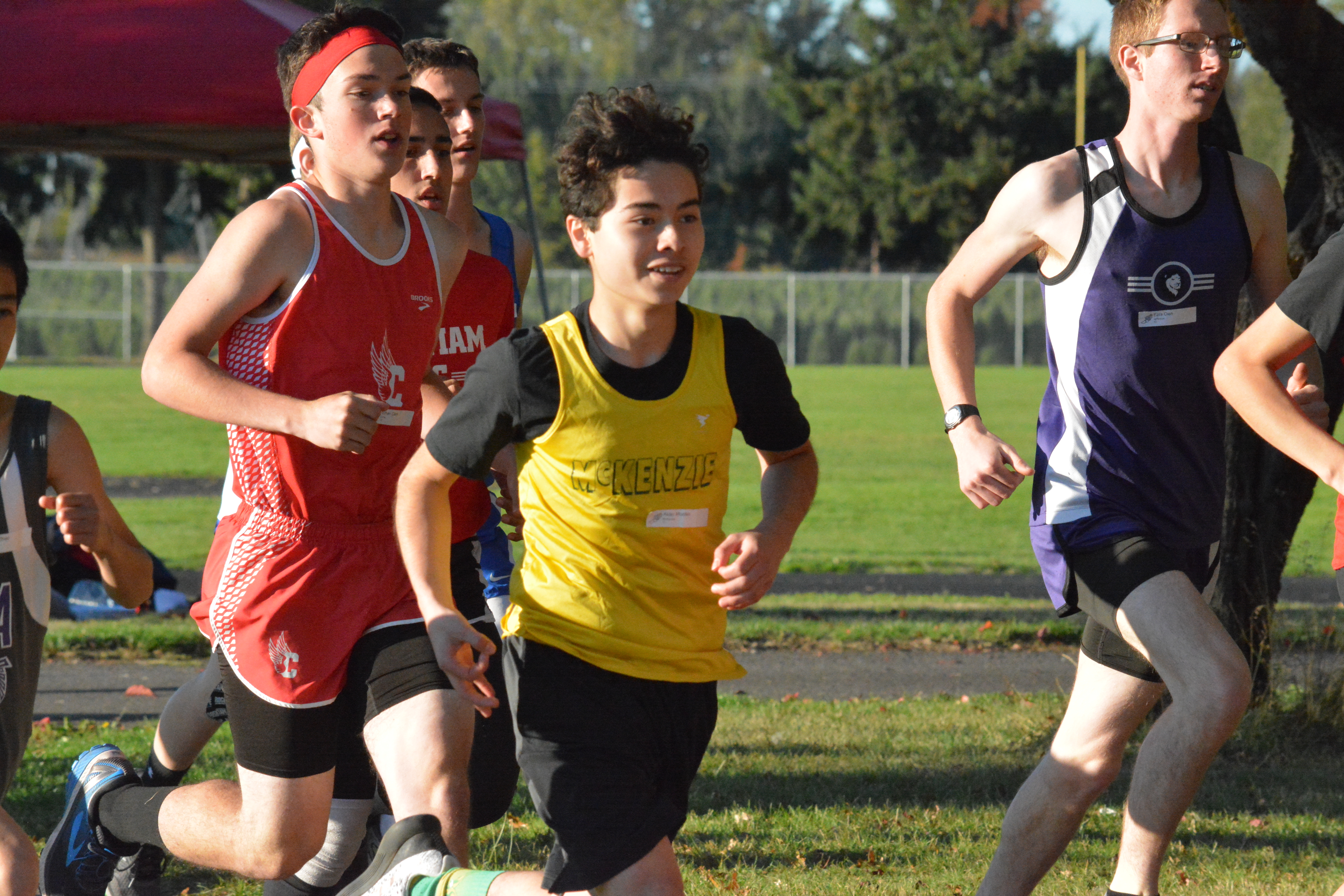 Student running in a cross country race.